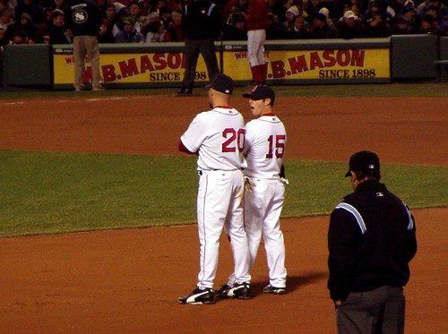 Youk and Pedroia confer