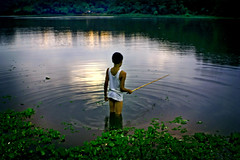 Peace of mind.................... (carf) Tags: poverty light boy sunset brazil lake reflection boys water brasil kids dark children hope kid fishing community support paradise peace child risk darkness sundown peaceful naturallight forsakenpeople esperana social impoverished underprivileged altruism eldorado reservoir haunting development prevention cristian billings atrisk riples mundouno diamondclassphotographer