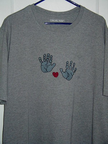 Embroidered hand prints and thumb print heart on T-shirt