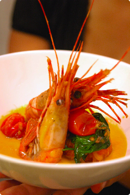 spot prawn in yellow tomato confit