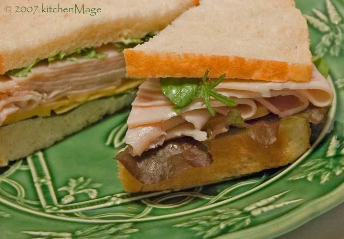 turkey and tillamook with microgreens on potato bread
