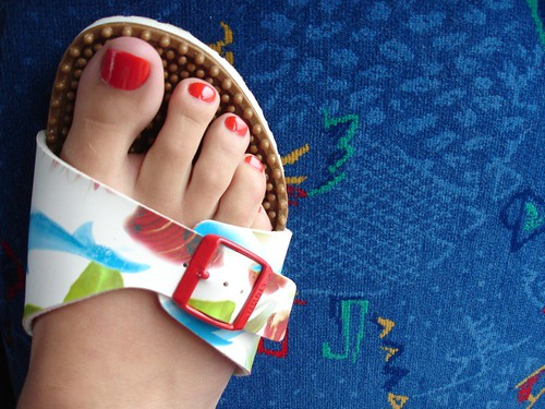 Red toe nail designs match with colorful berkinstocks, nail art for toenails