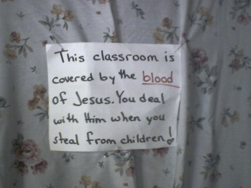 This classroom is covered by the blood of Jesus. You deal with Him when you steal from children!