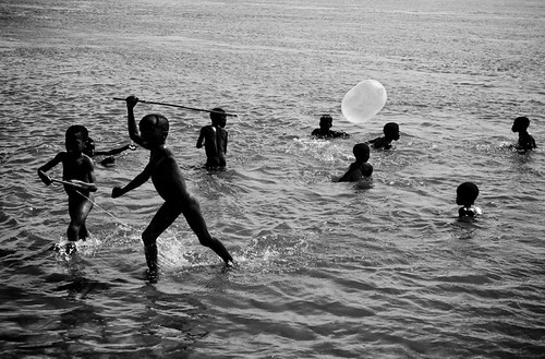 Naked Mozambican boys frolic with inflated condom balloons in the Zambezi. ph: Esther Havens