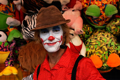 Carnival clown (Lil [Kristen Elsby]) Tags: carnival portrait stuffedtoy man color colour hat festival easter clown sydney makeup posed australia flashphotography friendly prize corduroy olympicpark homebush australasia oceania eastershow sydneyroyaleastershow environmentalportrait environmentalportraiture sydneyroyaleastershow2007