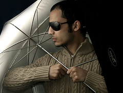 The umbrella armor (Abdullah AL-Naser) Tags: lighting light portrait selfportrait black reflection fashion darkroom umbrella self canon dark studio mirror interestingness interesting darkness room creative police style creation kuwait diffusion umbrel