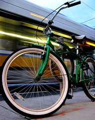 green bicycle, porter square (sandcastlematt) Tags: cambridge blur bus bike bicycle square dusk massachusetts porter portersquare bostonist lightstream interestingness5 universalhub guesswhereboston foundinboston notmybike