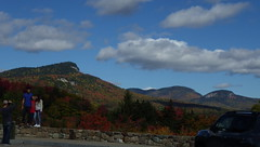 Experiencing Another Family's Joy - IMGP6643 (catchesthelight) Tags: northernnewengland nh nature mountains thekanc misspelled kangamangushighway kangamagushighway mustsee constructed 1959 traveled overamillionpeopleeachyear thekancamagushighway 34mileeastwestchannel 800000acre whitemountainnationalforest lincolnnhtoconwaynh trees change leaves summergreens breathtaking shadesofyellow red fall illuminated colorful dramatic enjoyable leafpeepingroute vistas views sky