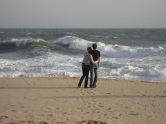 he's probably cheating on her (_melika_) Tags: ocean beach couple surf waves pacific lovers inlove thewedge
