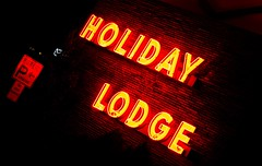 Lost Weekend (Thomas Hawk) Tags: two people usa holiday public sign night america neon unitedstates time side parking nevada unitedstatesofamerica picture lot tahoe motel laketahoe lodge hour sigh states limit southlaketahoe directs holidaylodge twohour