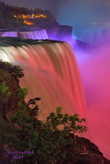 The Falls and Lights (JamesWatkins) Tags: longexposure nightphotography pink light usa ny newyork canada green art colors writing photography landscapes words lowlight poetry poem nightlights lakeerie purple unitedstatesofamerica niagrafalls creative beautifullight niagra falls waterfalls writers rivers nightlight newyorkstate sos beautifulcolors photographicart poems thefalls poets nightscapes westernnewyork canadianborder creativewriting niagraatnight tacomaartmuseum creativewriters nightfalls lowlightphotography niagrariver supershot d80 flickrsbest lightandcolors jameswatkins nikond80 pictureswithpoems waterfallsatnight aplusphoto diamondclassphotographer flickrdiamond frhwofavs poemsandpictures theunforgettablepictures picturesandpoems platinumheartaward niagranight goldstaraward tup2 goldstarawardgoldmedalwinner darkscapes thebestbronze flickrlovers colorsandlight landscapesatnight poemswithpictures famouswaterfalls