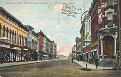 Main Street West From Market Street - Ottumwa, Iowa (The Cardboard America Archives) Tags: sign vintage store postcard iowa streetview xmarksthespot ottumwa glassessign