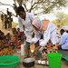 A mobile health extension officer demonstrating how to treat water and preparation of a child meal at Lubakda Kebele of Kori Woreda in Afar Regional state.