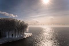 winter's grip (Marc McDermott) Tags: winter ice long exposure cold beautiful sunburst flare neutral density lake ontario canada mist clouds season