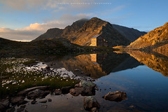 First Light (wende60) Tags: mountains sunrise lake reflection alps sarntal flaggerscharte cottongrass hike cabin hut shelter italy