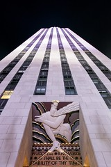 Wisdom and knowledge at the base of the rock (Lazy_Artist) Tags: rockefellercentre leelaurie night artdeco architecture newyorkcity