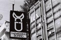 The Missing Burro (35mm) (jcbkk1956) Tags: bangkok thailand thonglo sign shippingcontainer restaurant mexican street mono blackwhite analog film 35mm ilford nikomat nikon nikkor manualfocus worldtrekker