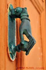the hand...and... (dimitra_milaiou) Tags: hand people door greece island architecture detail color colour paint tradition greek andros nikon d d90 90 day summer visit cyclades close up closeup milaiou dimitra orange texture light shadow life love live living art europe