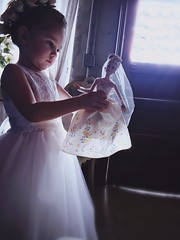 A Flower Girl's Fantasy (sydneyetalbot) Tags: innocence blonde texaswedding texas flowers child underlighting backlighting lighting aesthetic soft sunlight glow bride barbie prewedding flowergirl wedding