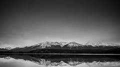 In Line (Sukhraj Hothi) Tags: sky lake canada mountains cold reflection water beautiful landscape rockies uniform jasper open pyramid wide rocky stretch alberta rough distance