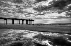 St Augustine Pier-Between Sea and Sky (Seaside Artistry) Tags: ocean sea sky blackandwhite beach pool clouds pier seaside seascapes florida stjohns tidal staugustine fishingpier silohuette