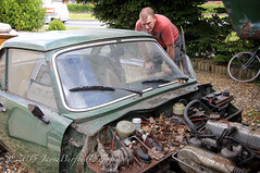 This may take longer than anticipated....... :) (JayBeee2) Tags: garage triumph spitfire care racinggreen