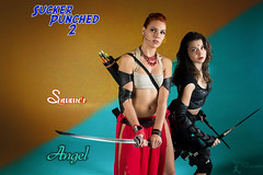 SP2: Summer and Angel (FightGuy Photography) Tags: leather emily cosplay redhead armor sword arrow brunette archer jax swords blades womenwithweapons groupshoot wakazashi suckerpunched union206 fightguyphotography womenwithswords cosplaywomen