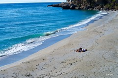 Beach (Kym.) Tags: andalucia andalusia beach blue day2 nerja people sea spain