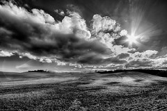 Val d'Orcia Explosion (Giulio Mazzini) Tags: sky cloud clody bn bw sun star countryside country siena orcia landscape italy tuscany explosion