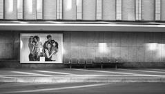This Side & Across (TablinumCarlson) Tags: europe deutschland germany brd niedersachsen lower saxony braunschweig leica brunswiek brunswick harz oker hanseatic league hansestadt hanse architektur winter sw bushaltestelle haltestelle station plakat familie family licht light schatten shadow leicam m m8 28mm summicron street streetphotography bus öpnv lichter