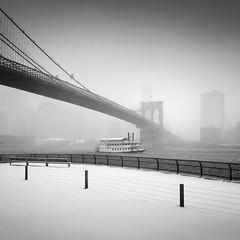 Queen of Hearts (Vesa Pihanurmi) Tags: nyc newyork brooklynbridge brooklyn snowstorm winter cityscape eastriver boat ship blaackandwhite monochrome fence poles landmark architecture