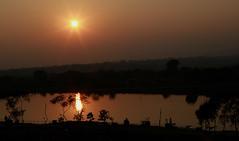 Dusk over Deoghar India (senguptapulak) Tags: dusk golden color reflection water sun set canon l lens star burst