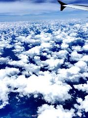 Flying over the clouds (K H Bradley-Black) Tags: clouds plane mothernature highaltitude flyinghigh backyardphotographer
