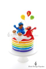 It's Elmo and Cookie Monster madness (Little Cottage Cupcakes) Tags: birthday cake balloons rainbow elmo sesamestreet cookiemonster fondant sugarpaste boycake littlecottagecupcakes furchesterhotel