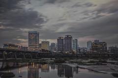 Evenings at the Floodwall (Joey Wharton) Tags: city bridge sunset building skyline river outdoors james virginia richmond va rva