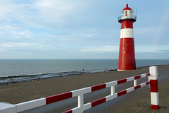 Lighthouse and fence (Jan van der Wolf) Tags: map14756v vuurtoren redrule seascape seaside shore red rood fence hek perspective lighthouse zeeland westkapelle landscape landschap redandwhite regenboog rainbow
