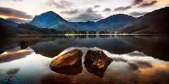 Buttermere Rocks (Dave Massey Photography) Tags: greatphotographers buttermere cumbria lakedistrict sunrise dawn haystack fleetwithpike rocks calm reflection mountains lake