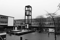 Stevenage - Explored (R.K.C. Photography) Tags: stevenage hertfordshire england unitedkingdom uk canoneos100d blackandwhite explored town fountain clocktower shops wilko sg1