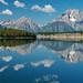 Grand Teton across Jackson Lake with Puffy Clouds