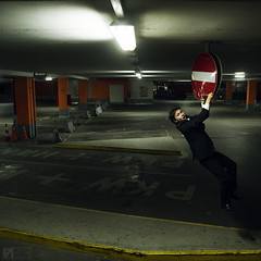 Leon Hanging (Felix Alexander Photo) Tags: street boy white black art sign businessman night dark way one funny industrial random space garage air parking fine young lot suit hanging surprised dangling clutching