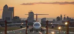 High wing and low lights (Olivier So) Tags: sunset london airport unitedkingdom symmetry canarywharf goldenhour bae146 cityairport lcy avrorj