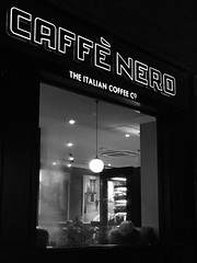 IMG_2219 (Kathi Huidobro) Tags: coffeeculture cafenero steamywindow neonsigns candid london coffeeshop watching streetphotography bw blackwhite neon neonsign afterdark nightlife