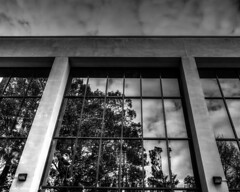 Stormy Reflection (that_damn_duck) Tags: architecture windows reflection storm clouds stormy columns bw blackwhite mirror