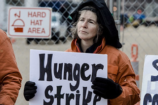 Mary Kate Holds a Sign at an Anti-Torture Demonstration Outside the White House