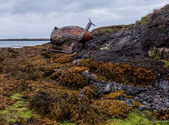 Boat (einisson) Tags: boat rocks iceland seaweed clouds outdoor einisson canon70d