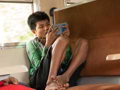 Escape (Tim Roper) Tags: myanmar yangon boy train circle smartphone burma portrait