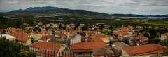 Trizina village panoramic view (kutruvis nick) Tags: trees houses sky mountains architecture clouds buildings landscape greek nikon village view rooftops hellas panoramic greece fields nik peloponnese argolida trizina d5100 kutruvis