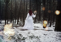 To Narnia (KaiaPieters) Tags: lagevuursche utrecht thenetherlands girl redhair alone candles white whitedress snow forest woods trees nature candlelabra candleholder fire light bokeh sparkler sparklers wandering lost narnia wardrobe closet magic magical fantasy