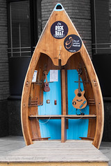 Music boat (Howard Ferrier) Tags: furniture ukelele guitar streetscape unitedkingdom england seat london cityoflondon sign booth music marinevessel musicalinstrument europe dinghy transport gb