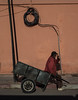 Street Geometry (Georgie Pauwels) Tags: geometry street wall cable cart sitting morocco streetphotography candid shadows olympus moment barrow